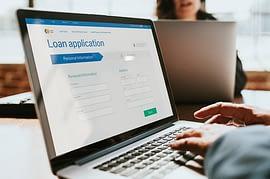 applying loan online through laptop